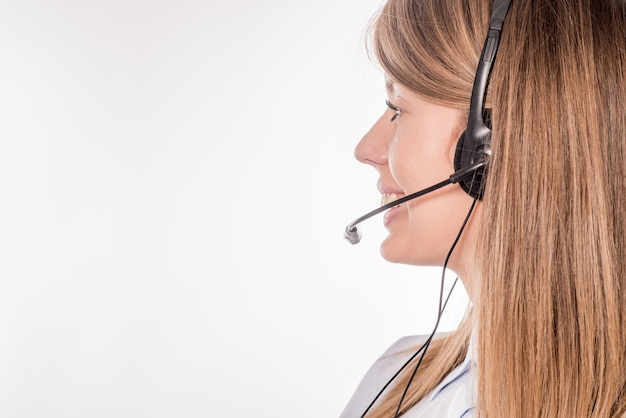 Customer support phone operator in headset, with blank copyspace area for slogan or text message, over white background. consulting and assistance service call center Free Photo