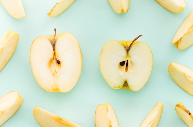 Cut apple on light surface Free Photo