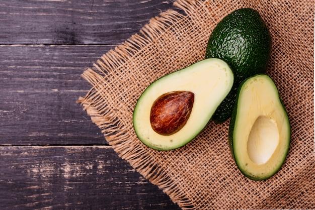 Cut by avocado against a dark background Premium Photo