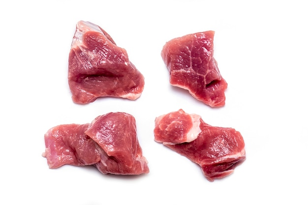 Cut pieces of raw meat pork, beef isolated on white background Premium Photo