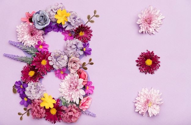 Cute 8th of march symbol made out of flowers Free Photo
