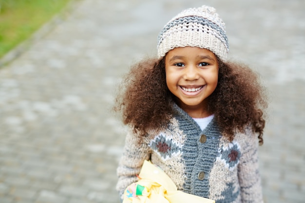 Cute african-american girl wearing knits Free Photo