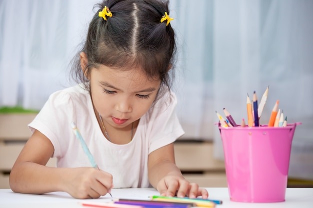 Cute Asian Child Girl Having Fun To Draw And Paint With