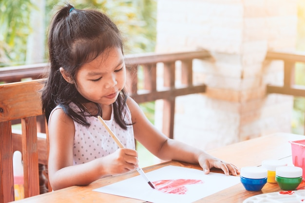 Cute Asian Little Child Girl Drawing And Painted A Heart For