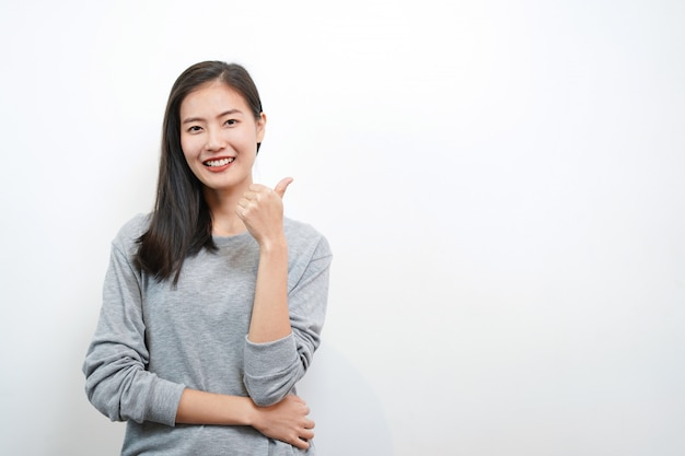 Cute asian woman smile and thumb up. happy and positive concept Premium Photo