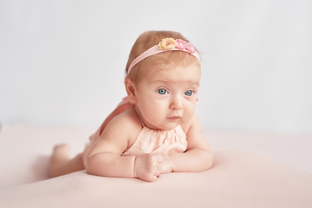 Cute baby 3 months on a light Premium Photo