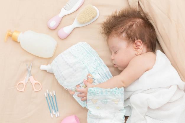 Cute baby girl sleeping safely. Premium Photo