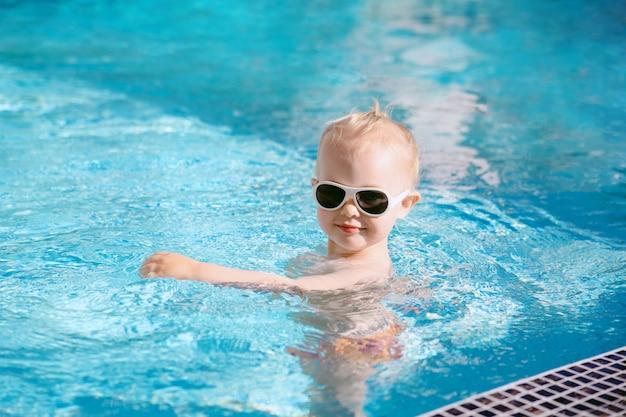 A cute baby at pool. Premium Photo