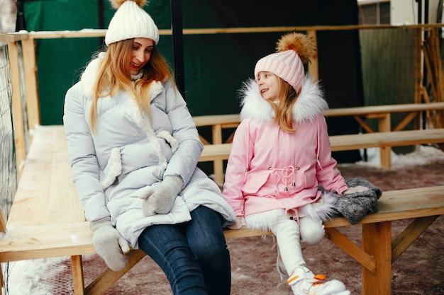 Cute and beautiful family in a winter city Free Photo