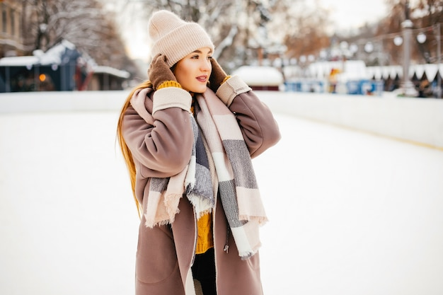 Cute and beautiful girl in a winter city Free Photo
