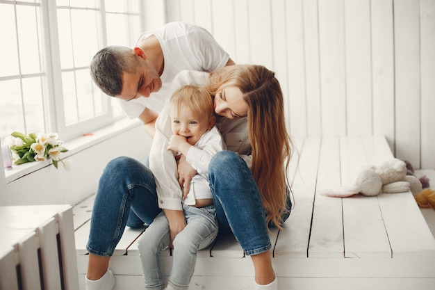 Cute and big family sitting at home Free Photo