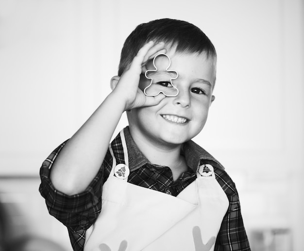 Cute boy with a christmas cookie cutter Free Photo