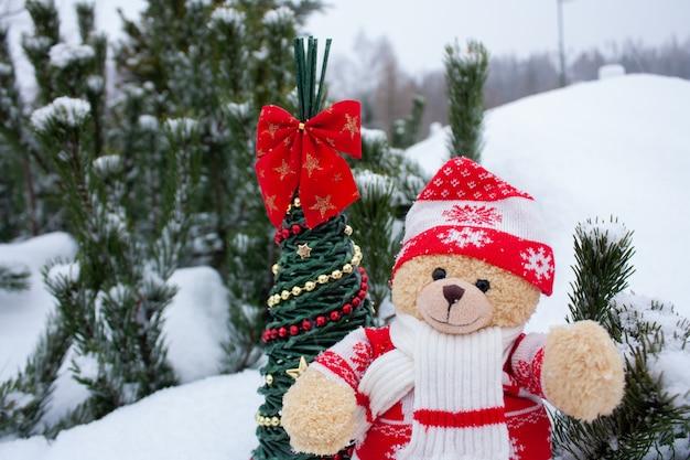 Cute brow teddy bear on white snow brackground Premium Photo