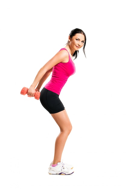 Cute brunette woman during fitness exercise Free Photo