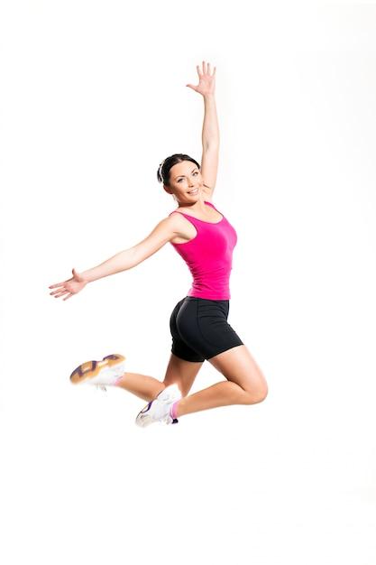Cute brunette woman jumping Free Photo