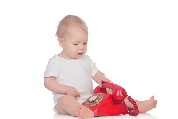 Cute caucasian baby playing with telephone Premium Photo