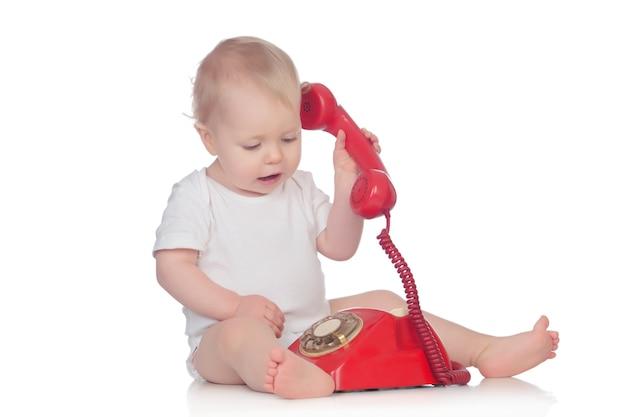 Cute caucasian baby playing with telephone Premium Photo