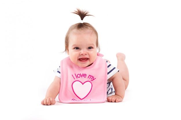 Cute cheerful little girl in pink  bib Premium Photo