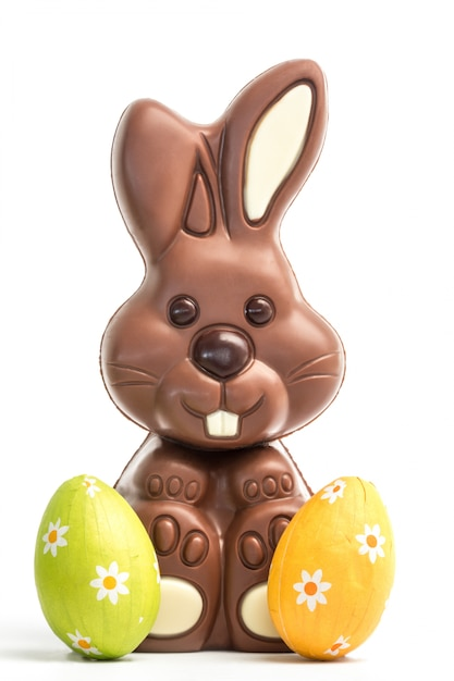 Cute Chocolate Bunny With Two Easter Eggs Premium Photo