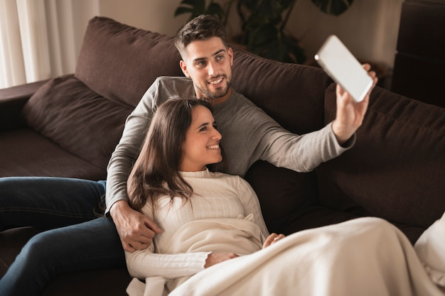 Cute couple at home on couch mock-up Free Photo