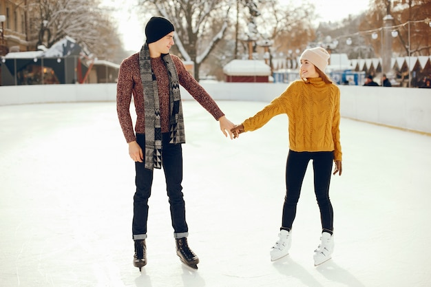 Cute couple in a ice arena Free Photo