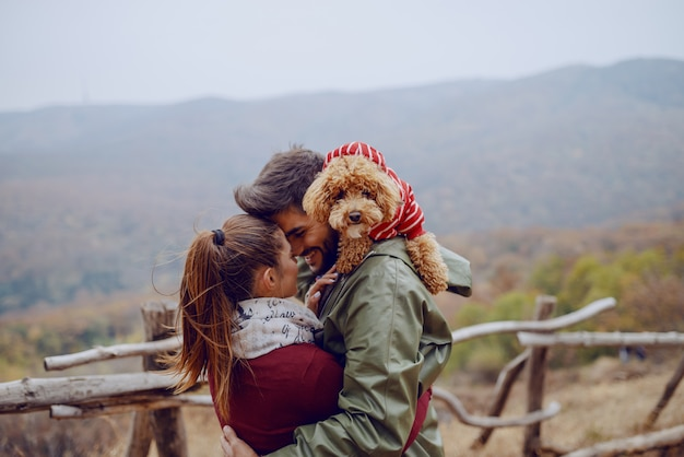 Cute couple in love standing in nature and cuddling. Premium Photo