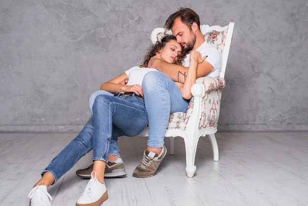 Cute couple sleeping in armchair | Free Photo