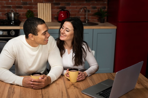 Cute couple smiling at each other Free Photo