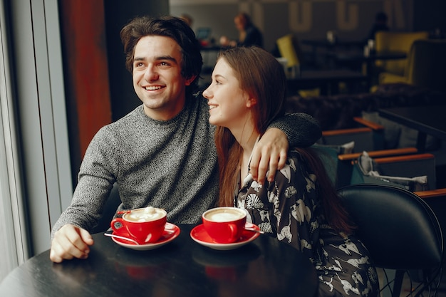 Cute couple spend time in a cafe Free Photo