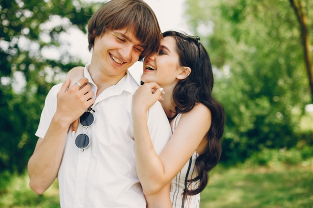 Cute couple in a summer park Free Photo