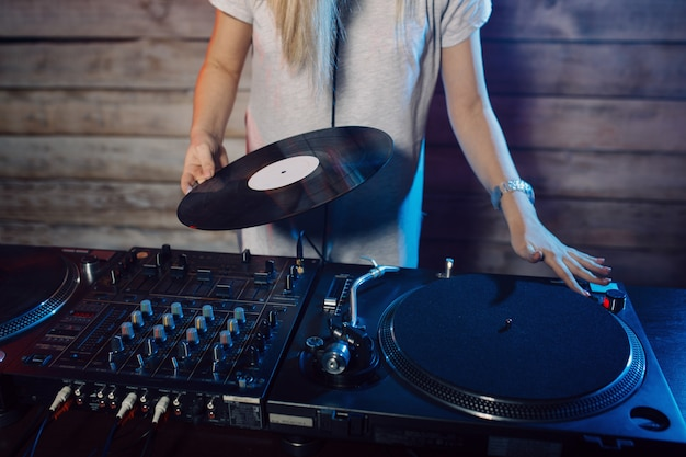 Cute dj woman having fun playing music at club party Free Photo