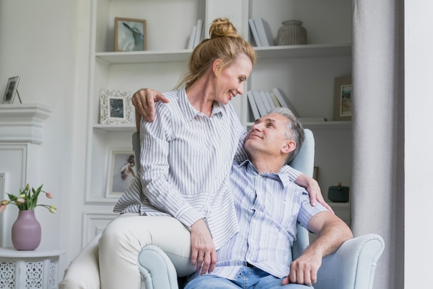 Cute elderly couple together on a sofa Free Photo