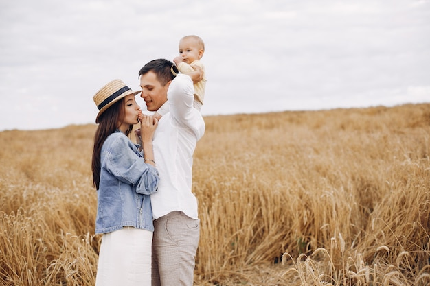 Cute family playing in an autumn field Free Photo