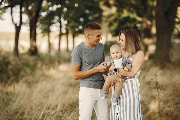 Cute family playing in a autumn field Free Photo