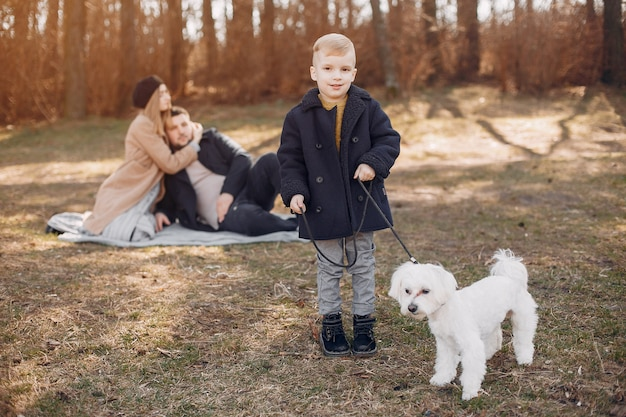 Cute family playing in a park Free Photo