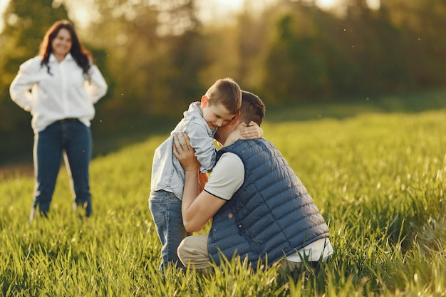 Cute family playing in a summer field Free Photo