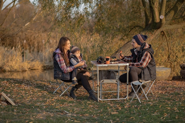 Cute family sitting on a picnic in a forest Free Photo