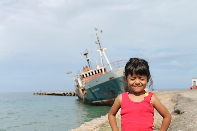 Cute funny girl on the beach Premium Photo