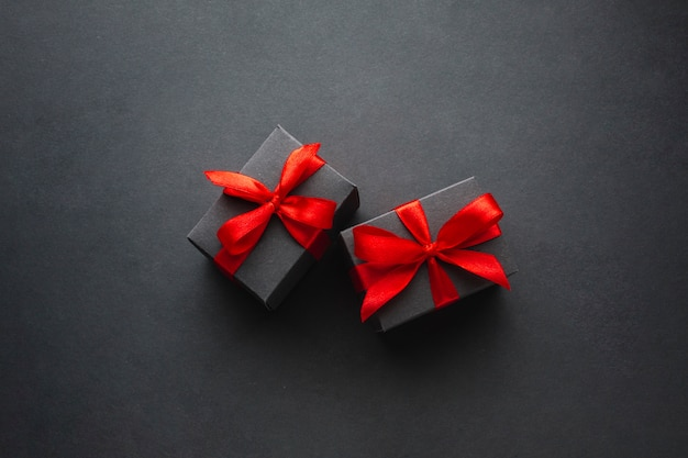 Cute gift boxes on black background Free Photo