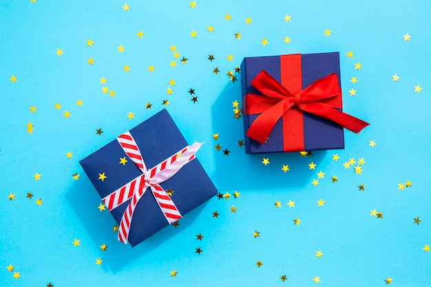Cute gifts with sparkles on blue background Free Photo