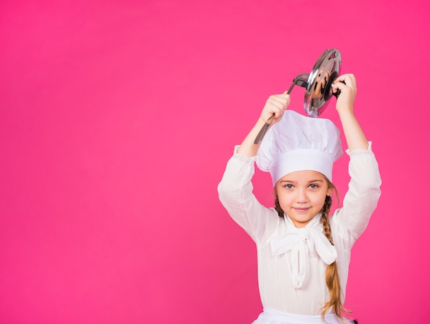 Cute girl cook with ladle and cover smiling Free Photo