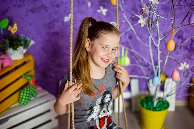 Cute girl in easter decorated room Premium Photo
