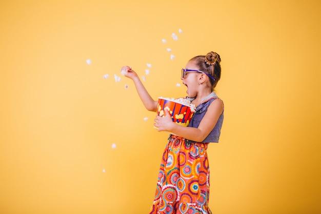 Cute girl eating popcorn Free Photo