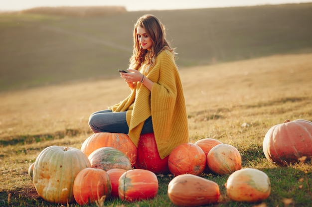 Cute girl have a rest in a autumn park Free Photo