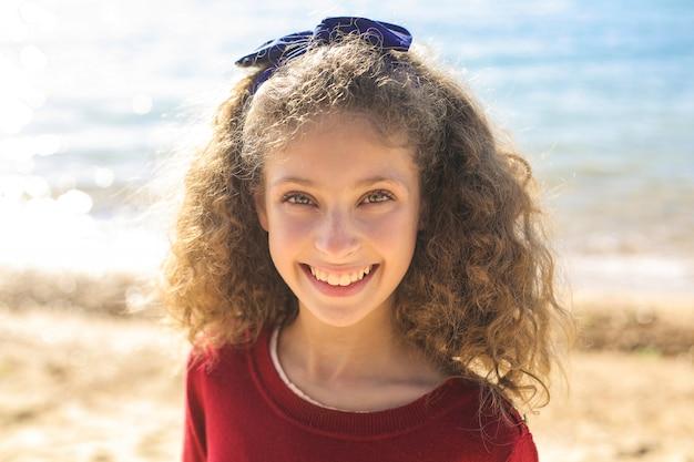 Cute girl having good time at the beach Premium Photo