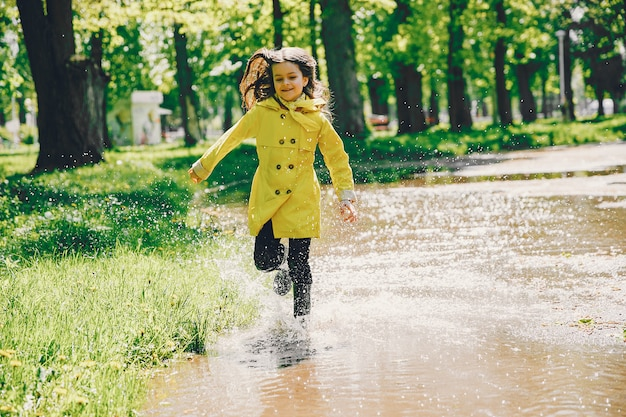 Cute girl plaiyng on a rainy day Free Photo