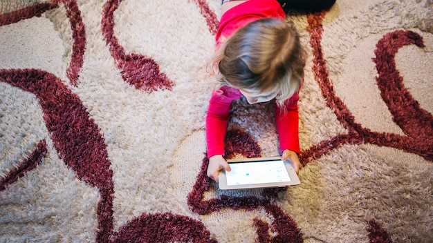 Cute girl playing tablet game Free Photo