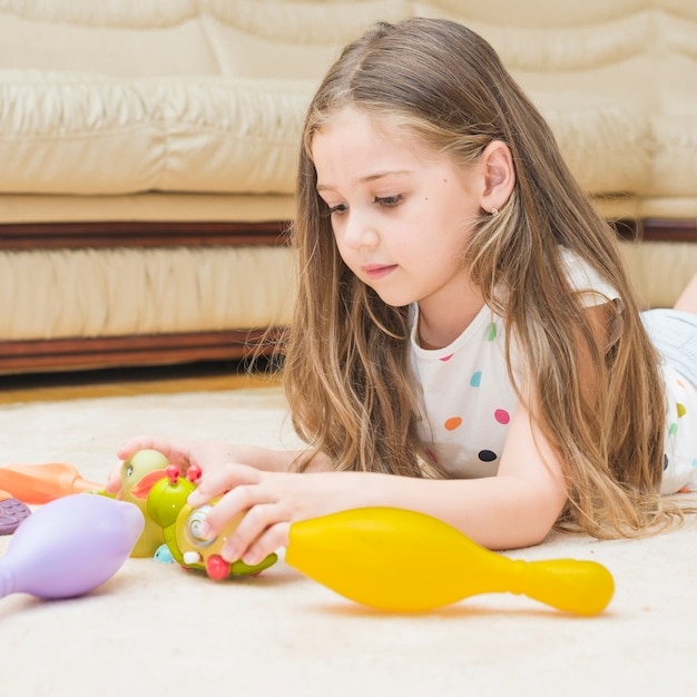 Cute girl playing with toys at home Free Photo