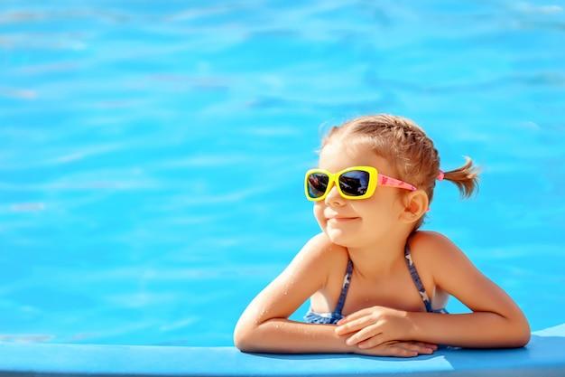 Cute girl in pool Premium Photo