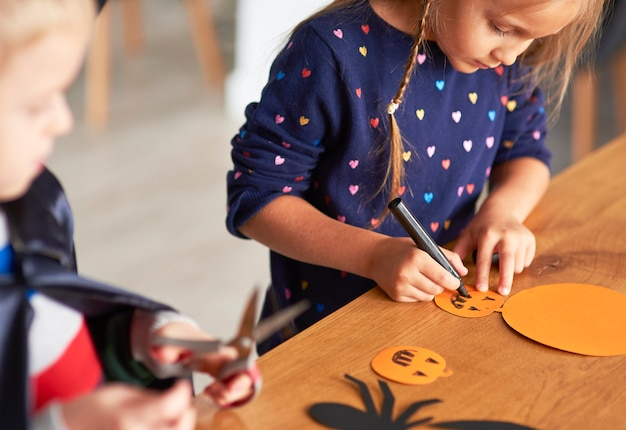 Cute girl preparing halloween decorations Free Photo